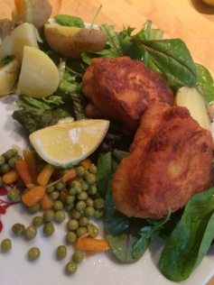 Fried fish with salad and boiled potatoes